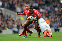 Mathieu Bastareaud of RC Toulon is tackled by Benjamin Kayser of ASM Clermont Auvergne