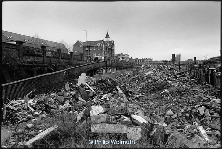 Piles of rubble on the Railway Lands development site, King's Cross, London 1989.