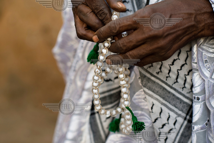 Prayer beads in the hands of Afa Dauda, a traditional healer, in Nyankpal. In Ghana, mental illness is typically seen as having a spiritual cause, and so for many traditional or faith healers are often the first point of call. As for many Ghanaians, traditional animist beliefs sit alongside his conventional faith - Islam, in this instance - and this is reflected in his treatments. In a country of 24 million, Ghana has only 12 public psychiatrists, but approximately 45 000 traditional healers.