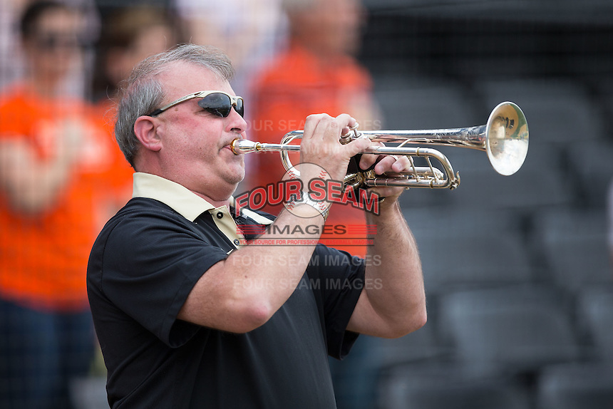 Dr. C. Kevin Bowen, Director of Bands at Wake Forest University, plays the National Anthem on his trumpet prior to the ACC baseball game between the Clemson Tigers and the Wake Forest Demon Deacons at David F. Couch Ballpark on March 12, 2016 in Winston-Salem, North Carolina.  The Tigers defeated the Demon Deacons 6-5.  (Brian Westerholt/Four Seam Images)