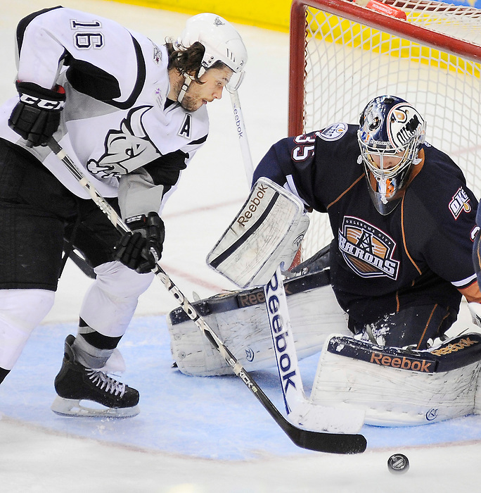 San Antonio Rampage's Bracken Kearns (16) shoots on Oklahoma City Barons goaltender Yann Danis during the third period of an AHL hockey game, Monday, May 7, 2012, in San Antonio. Oklahoma City won 2-1 in overtime. (Darren Abate/pressphotointl.com)
