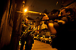 Rio's Elite Special Forces Police Unit Batalhão de Operações Policiais Especiai, or BOPE, patrol the Parque Alegria favela a joint public security operation to install a Pacifying Police Unit (UPP) at the Caju favela complex in Rio de Janeiro, Brazil, Sunday, March 3, 2013. The elite police units backed by armored military vehicles and helicopters invaded the neighborhood of 13 communities in Caju favela complex early Sunday in an on-going policing program aimed to drive violent and heavily armed drug gangs out of Rio's poor communities, where the traffickers have ruled for decades.