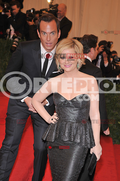 Will Arnett and Amy Poehler at the 'Schiaparelli And Prada: Impossible Conversations' Costume Institute Gala at the Metropolitan Museum of Art on May 7, 2012 in New York City. © mpi03/MediaPunch Inc.
