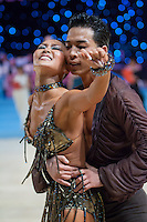 Shinsuke Kanemitsu and Natsuko Yoshida from Japan perform their dance during the professional rising stars latin-american competition of the UK Open dance competition. International Centre,  Bournemouth, United Kingdom. Tuesday, 22. January 2008. ATTILA VOLGYI