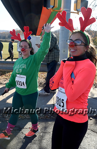 Runners decked out in reindeer antlers head to the start finish line during the 81st running of the Manchester Road Race, Thursday, November 23, 2017, in  Manchester. (Jim Michaud / Journal Inquirer)