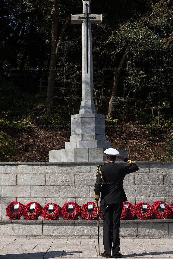 A military officer lays a wreath and salutes during a ceremony for Remembrance Sunday at the Commonwealth War Graves Cemetery in Hodogaya, Yokohama, Japan. Sunday November 13th 2016. Each year representatives of the Commonwealth nations, along with American and other European nations that lost servicemen fighting the Japanese in World War 2, hold a multi-faith service of remembrance at this cemetery. This is the only cemetery for war dead in japan that is managed by the Commonwealth War Graves Commission.