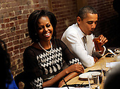United States President Barack Obama and First Lady Michelle Obama have dinner with winners of a campaign contest at Boundary Road, on Thursday, March 8, 2012, in Washington, DC. .Credit: Leslie E. Kossoff / Pool via CNP