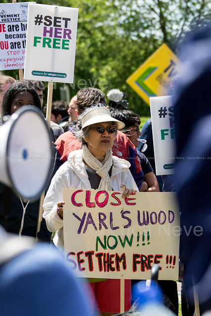 Bedford (Bedfordshire, England), 06/06/2015. Today, hundreds of protesters, activist and member of the public gathered outside the notorious Yarl's Wood I.R.C. Immigration Removal Centre in Bedfordshire, to protest against the alleged inhuman conditions of the detainees (showed in a recent Channel 4 undercover investigation - http://bit.ly/1E6X4pz) and to call for its immediate closure. &lt;&lt;Yarl's Wood Immigration Removal Centre is a detention centre for foreign nationals prior to their deportation from the United Kingdom, one of 13 such centres currently in the UK. It is located near Milton Ernest in Bedfordshire, England, and is operated by Serco (British outsourcing company based in Hook, Hampshire. It operates public and private transport and traffic control, aviation, military weapons, detention centres, prisons and schools on behalf of its customers &ndash; Source Wikipedia.com), who describe the place as &quot;a fully contained residential centre housing adult women and adult family groups awaiting immigration clearance.&quot; Its population is, and has been, overwhelmingly female. [&hellip;]&gt;&gt; (Source - Wikipedia.com at http://bit.ly/1GiTFWB).<br /> <br /> For more information please click here:  http://on.fb.me/1eWzNhL &amp; http://www.movementforjustice.org/
