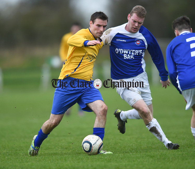David Mc Carthy of Clare in action against Owen Hanrahan of Limerick during their FAI Oscar Traynor game in Limerick. Photograph by John Kelly.