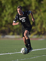 Oct 29, 2014; Orange, CA, USA; Occidental College Tigers defender Bryant McLafferty (15) against the Chapman College Panthers. Photo by Kirby Lee
