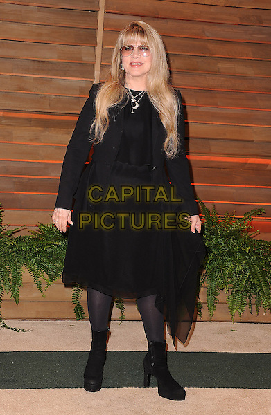 WEST HOLLYWOOD, CA - MARCH 2: Stevie Nicks arrives at the 2014 Vanity Fair Oscar Party in West Hollywood, California on March 2, 2014.  <br /> CAP/MPI/MPI213<br /> &copy;MPI213/MediaPunch/Capital Pictures