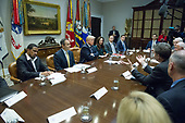 Governor Sam Brownback (Republican of Kansas), right, makes remarks during a prison reform roundtable convened by United States President Donald J. Trump in the Roosevelt Room of the White House in Washington, DC on Thursday, January 11, 2018.  <br /> Credit: Ron Sachs / CNP