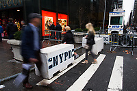 NEW YORK, NY - APRIL 4: pedestrians walk along 5av as NYPD officers stand guard in a booth at 56 street around Trump Tower Where United States First Lady Melania Trump is living on April 4, 2017 in Manhattan, New York. Police Commissioner James O'Neill told lawmakers in February it costs the NYPD between $127,000 and $146,000 a day to protect the first lady and her 11-year-old son Barron. When the president is in town, the city pays more than $308,000.  Photo by VIEWpress/Eduardo MunozAlvarez