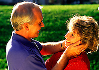 A smiling mature couple in an affectionate pose.