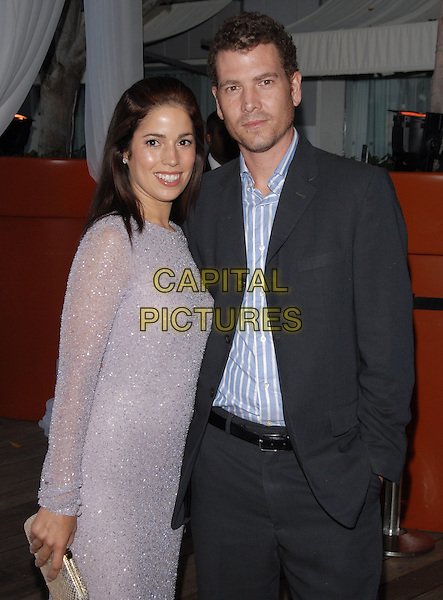 ANA ORTIZ & HUSBAND NOAH LEBENZON.at The Ugly Betty: The Complete First Season - The Bettyfied Edition DVD Launch Event held at Skybar in West Hollywood, California, USA, August 20th 2007.                                                                     half length grey silver sparkly dress married couple.CAP/DVS.©Debbie VanStory/Capital Pictures