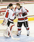 Leah Sulyma (NU - 1), Alyssa Wohlfeiler (NU - 8) - The Harvard University Crimson defeated the Northeastern University Huskies 4-3 (SO) in the opening round of the Beanpot on Tuesday, February 8, 2011, at Conte Forum in Chestnut Hill, Massachusetts.