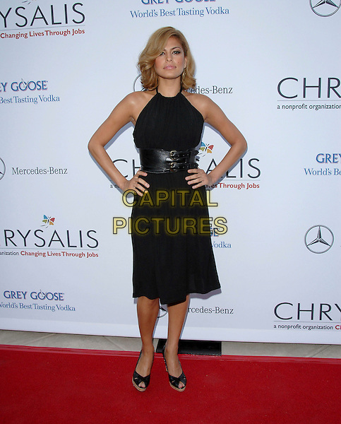 EVA MENDES.Attends The Chrysalis' Fifth Annual Butterfly Ball held at The Italian Villa of Carla and Fred Sands in Bel Air, Los Angeles, California, USA, June 10th 2006..full length black dress hands on hips waist cincher belt buckles platform peeptoe shoes.Ref: DVS.www.capitalpictures.com.sales@capitalpictures.com.©Debbie VanStory/Capital Pictures