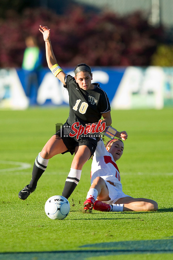 Bianca D'Agostino #10 of the Wake Forest Demon Deacons fights for the ball against Amy O'Sullivan #15 of the Maryland Terrapins at the 2010 ACC Women's Soccer Championship at WakeMed Soccer Park on November 7, 2010 in Cary, North Carolina.  The Demon Deacons defeated the Terrapins 3-1 in penalty kicks.  Photo by Brian Westerholt / Sports On Film