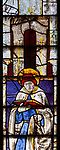 Sixteenth century stained glass window detail Fairford, Gloucestershire, England, UK hidden portrait Bishop Edward Fox d 1528