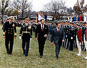 United States President Ronald Reagan, right center, U.S. Secretary of Defense Caspar Weinberger, right, and U.S. Navy Admiral William J. Crowe, Jr., Chairman of the Joint Chiefs of Staff, left, are shown Trouping the Line escorted by Colonel James F. Hennessee, Commander, 3rd U.S. Infantry, left center, at the Pentagon in Washington, D.C. on Tuesday, November 17, 1987.  Earlier the President spoke at a farewell ceremony hosted by Admiral Crowe honoring Secretary Weinberger.  Weinberger was awarded the Presidential Medal of Freedom with Distinction, and the highest civilian public service awards by the Army, Navy, and Air Force..Mandatory Credit: Helene Stikkel - DoD via CNP