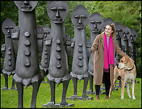 BNPS.co.uk (01202 558833)<br /> Pic: PhilYeomans/BNPS<br /> <br /> Bea Fomin with Theo the Great Dane from Roche Court explore the new exhibit.<br /> <br /> Artists Zak Ové 'Black and Blue: The Invisible Man and the Masque of Blackness' has gone on display in the tranquil surroundings of the New Art Centre at Roche Court near Salisbury in Wiltshire.<br /> <br /> The 40 graphite, 7ft tall figures, form a striking exhibit at the the 19th century house which was turned into a art gallery and sculpture park by Lady Bessborough in the 1990's using the verdant grounds to showcase some striking contemporary art by famous modern artists.