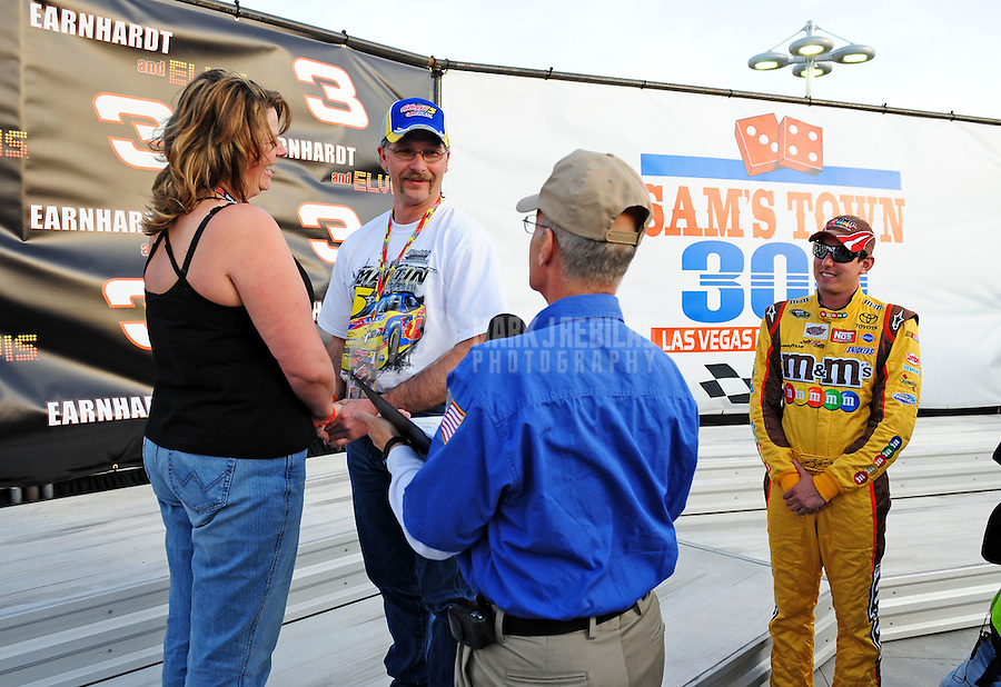 Feb. 27, 2009; Las Vegas, NV, USA; NASCAR Sprint Cup Series driver Kyle Busch (right) jokingly acts as the best man as fans Heather Landry and Damon Landry get married in victory lane following qualifying for the Shelby 427 at Las Vegas Motor Speedway. Mandatory Credit: Mark J. Rebilas-