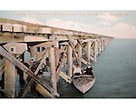 Trestle between Long Key and Lower Matecumbe Key with a boat<br /> from the Long Key Fishing Camp, Florida Keys