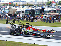 Apr 22, 2018; Baytown, TX, USA; NHRA top fuel driver Brittany Force (near) alongside Doug Kalitta during the Springnationals at Royal Purple Raceway. Mandatory Credit: Mark J. Rebilas-USA TODAY Sports