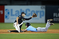 Ocelotes de Greensboro shortstop Connor Kaiser (18) fields the throw as Jax Biggers (2) of the Hickory Crawdads slides head first into second base at First National Bank Field on June 11, 2019 in Greensboro, North Carolina. The Crawdads defeated the Ocelotes 2-1. (Brian Westerholt/Four Seam Images)