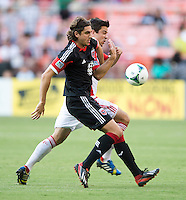 Dejan Jakovic (5) of D.C. United fights for the ball with Andrew Wiedeman (32) of Toronto FC during a game at RFK Stadium in Washington, DC.  D.C. United tied Toronto FC, 1-1.