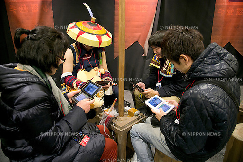 "January 22, 2015, Osaka, Japan : Visitors play video games at the ""MONSTER HUNTER: THE REAL"" attraction in the Universal Studios Japan. The UNIVERSAL COOL JAPAN event showcases Japan's top entertainment brands (EVANGELION: THE REAL 4D, Attack on Titan: THE REAL, BIOHAZARD: THE SCAPE and MONSTER HUNTER: THE REAL) to the world and runs from January 23 to May 10 2015 at Universal Studios Japan. (Photo by Rodrigo Reyes Marin/AFLO)"