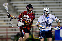 Ryan Flanagan (24) of North Carolina defends Will Yeatman (23) of Maryland during the ACC men's lacrosse tournament semifinals in College Park, MD.  Maryland defeated North Carolina, 13-5.