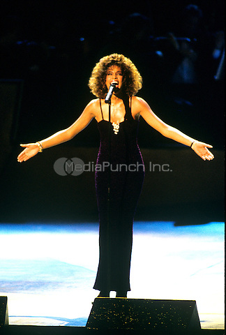 Whitney Houston performing in NYC circa 2000. ©RTBusacca / MediaPunch