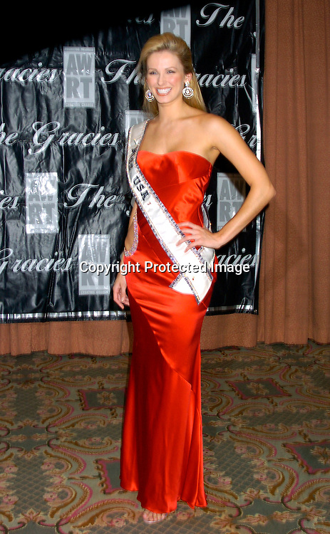 Miss USA Shandi Finnessey in Stephen Yearick ....at the 2004 Gracie Allen Awards on June 22, 2004 at The New York Hilton.  American Women in Radio & Television ..Gracie Allen Awards Gala celebrates exemplary programming created for women, by women and about ..women...Photo by Robin Platzer, Twin Images