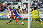 22 August 2015: New York's Raul (ESP) (7) gets behind Carolina's Mamadou Futty Danso (GAM) (left), but has his shot saved by Carolina's Akira Fitzgerald (12). The Carolina RailHawks hosted the New York Cosmos at WakeMed Stadium in Cary, North Carolina in a North American Soccer League 2015 Fall Season match. Cosmos won the game 3-1.