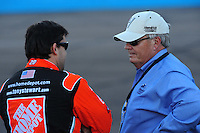 Nov. 7, 2008; Avondale, AZ, USA; NASCAR Sprint Cup Series team owner Rick Hendrick (right) talks with Tony Stewart during qualifying for the Checker Auto Parts 500 at Phoenix International Raceway. Mandatory Credit: Mark J. Rebilas-