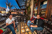 Men smoking sheesha (water pipe) at an outdoor cafe, Aqaba, Jordan