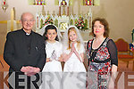 Making their First Holy Communion was Sarah Jayne Walsh and Lisa Curtin Farrelly from Scoil Mhuire NS, pictured here with Fr Mangan and Carmel O'Connell last Saturday in Knocknagoshal.