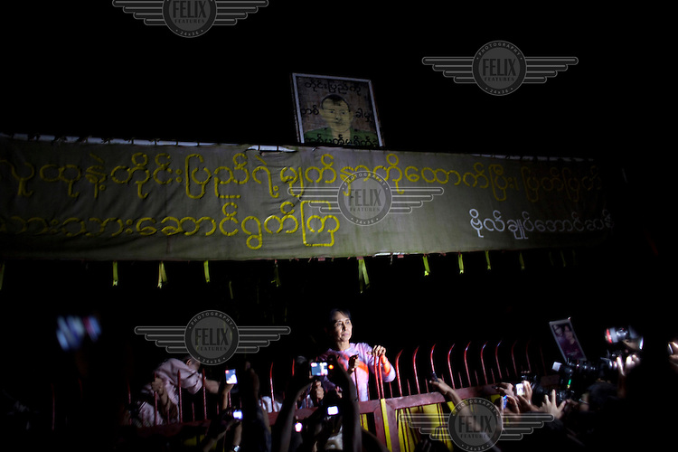 Aung San Suu Kyi talks to her supporters and media at her home following her release from house arrest in Rangoon. From 1990 until her release on 13 November 2010, Aung San Suu Kyi had spent almost 15 of the 21 years under house arrest.