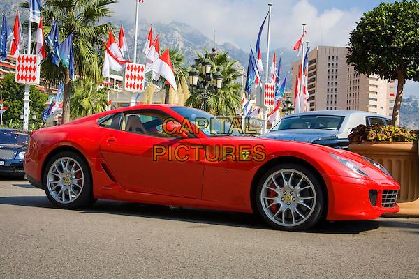 Red Ferrari sports car, Place Du Casino, Monte Carlo, Monaco, France
