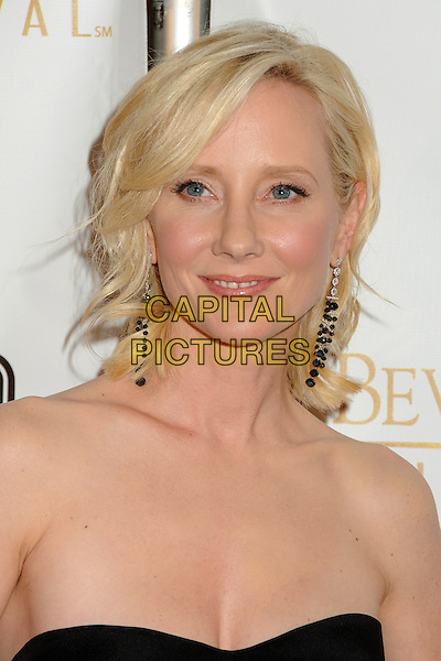 Anne Heche.12th Annual Beverly Hills Film Festival Opening Night held at the AMPAS Samuel Goldwyn Theater, Beverly Hills, California, USA..April 25th, 2012.headshot portrait dangling earrings black strapless cleavage .CAP/ADM/BP.©Byron Purvis/AdMedia/Capital Pictures.
