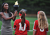Crystal Dunn, a Rockville Centre native and member of the 2016 US women's olympic soccer team, gets presented with a hand-made replica of the Olympic torch from members of the local youth soccer league during a ceremony honoring Dunn at Hempstead State Park on Wednesday, July 13, 2016.