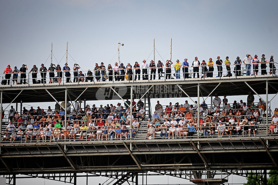 May 28, 2010; Indianapolis, IN, USA; IndyCar Series spotters watch from the roof of the main grandstands as fans watch below during carb day prior to the Indianapolis 500 at the Indianapolis Motor Speedway. Mandatory Credit: Mark J. Rebilas-