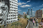 Taken on the High Line in New York City's Chelsea District. The Highline was an elevated train track built in the 1930's to serve the transportation needs of the city's meatpacking industry.  It was restored over the past decade as a nearly two mile promenade adorned with beautiful art, landscaping, and views of the city.