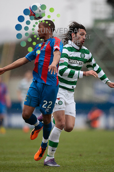 Scottish Cup 5th round; Inverness Caley V Celtic..ICT's Kenny Gillet wins an ariel battle with Celtic's Giorgios Samaras.  3/2/12 John MacTavish, Universal News and Sport (Europe)
