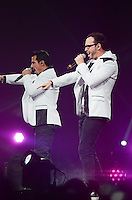 Danny Wood and Donnie Walhberg of The New Kids on The Block perform at BB&T Center during The Package Tour 2013, Sunrise, Florida, June 22, 2013