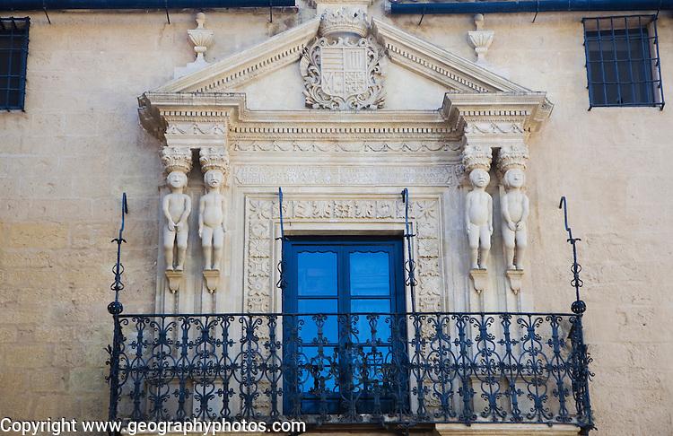 Carved figures of South American indians on the facade of the Palacio de los Marqueses de Salvatierra, Ronda, Spain