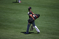 SAN FRANCISCO, CA - JULY 6:  Buster Posey #28 of the San Francisco Giants walks on the field while wearing a mask during summer training camp at Oracle Park on Monday, July 6, 2020 in San Francisco, California. Due to COVID-19, the 2020 MLB season has been postponed with players just beginning to return for warmups and practices while wearing masks and keeping social distance. (Photo by Brad Mangin)