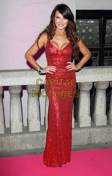 Lizzie Cundy<br /> The Inspiration Awards For Women 2013, Cadogan Hall, Sloane Terrace, London, England.<br /> October 2nd, 2013<br /> full length red sequins sequined dress hands on hips <br /> CAP/ROS<br /> &copy;Steve Ross/Capital Pictures