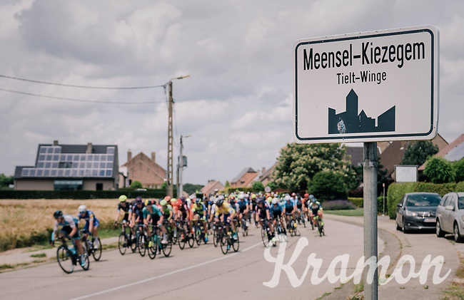 peloton racing through Meensel-Kiezegem; the (small) birthtown of cycling legend Eddy Merckx<br /> <br /> 3rd Dwars Door Het hageland 2018 (BEL)<br /> 1 day race:  Aarschot > Diest: 198km